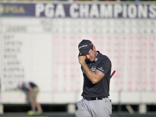 Jason Day is overcome with emotion after sinking his final putt on the 18th hole during the final round of the PGA Championship on Sunday, Aug. 16, 2015, at Whistling Straits in Haven, Wis. He finished 20 under par. (Rick Wood/Milwaukee Journal Sentinel/TNS)