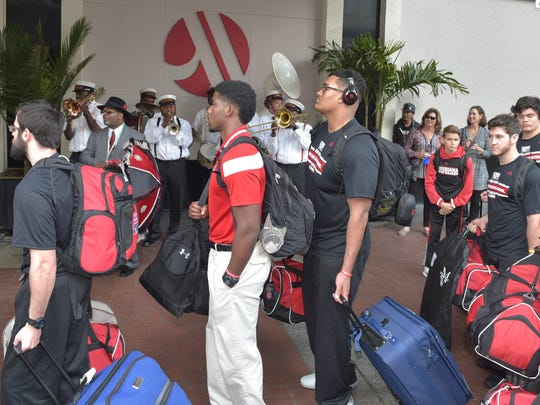 Louisiana Ragin Cajuns football team arrives to the sounds of the Kinfolk Jazz Band Tuesday at the Marriot Hotel in New Orleans.