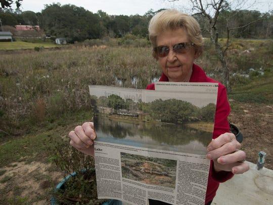 Sara Fiveash displays a newspaper clipping showing