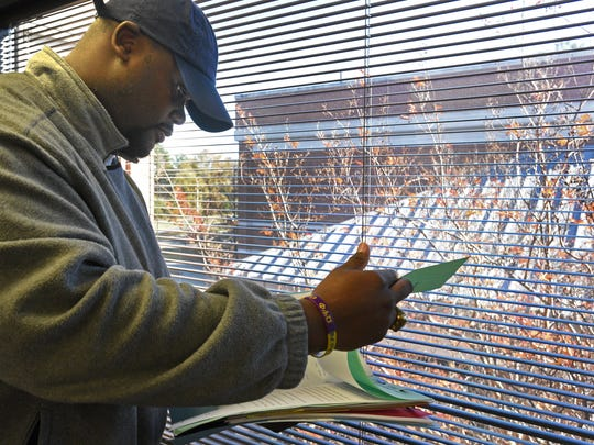 Probation officer LaMarcus Williams reviews a file at the Caddo Parish Juvenile Court.