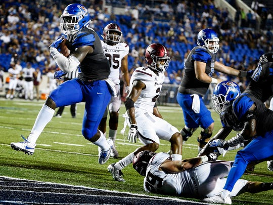 University of Memphis running back Patrick Taylor Jr. (left) scrambles past the Southern Illinois University defense for a touchdown at the Liberty Bowl Memorial Stadium Saturday, September 23, 2017.