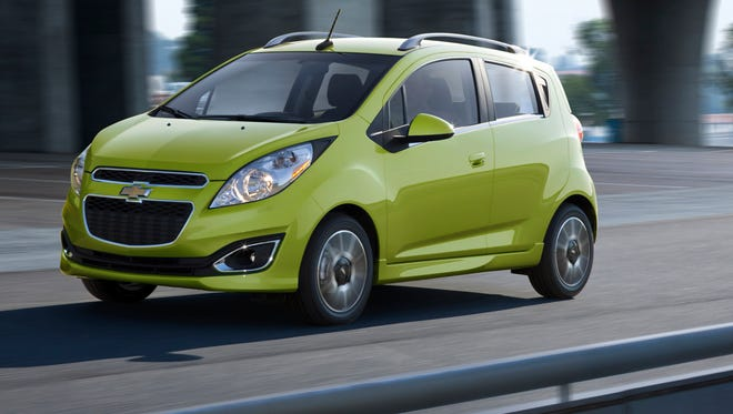 Chevrolet Spark EV battery car. Chevy is cutting $1,650 from the price, making the car as low as $14,995 after all-available government credits for EV buyers and Chevy discount.