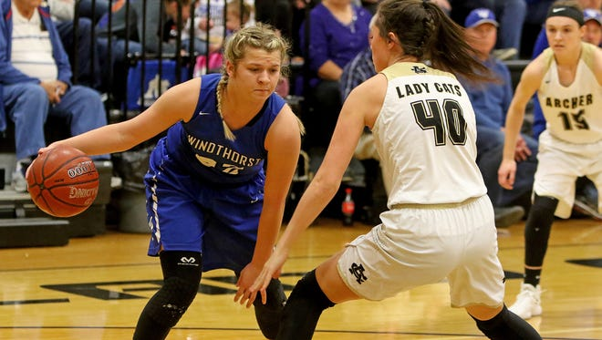 Windthorst's Tatum Veitenheimer dribbles while guarded by Archer City's Kacey Hasley Tuesday, Jan. 9, 2018, in Archer City.