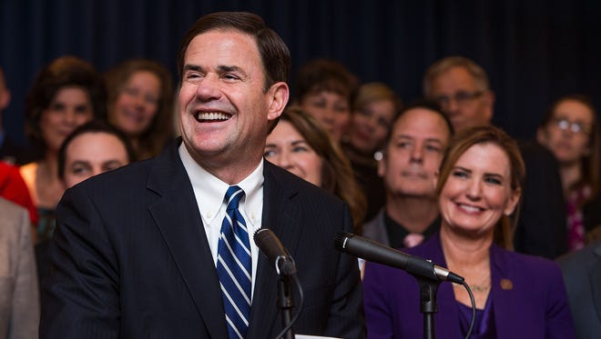 Arizona Gov. Doug Ducey announced a new package to increase compensation for teachers during a news conference at the Capitol in Phoenix on Thursday, April 12, 2018.