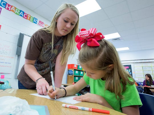 Pintlala Elementary School third grade teacher Jasmine Andrews works with students as they make cards and fill gift baskets for local senior citizens as part of their Random Acts of Kindness Week at the school in Pintlala, Ala. on Thursday February 18, 2016.