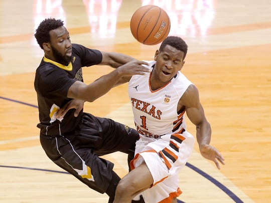 UTEP's Dominic Artis collides hard with Southern Miss guard Khari Price in the first half of their game Thursday at the Don Haskins Center.
