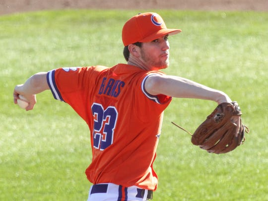 Clemson junior pitcher Charlie Barnes (23) pitches to Wright State junior T.T. Morrow during the top of the first inning on Friday at Doug Kingsmore Stadium in Clemson.