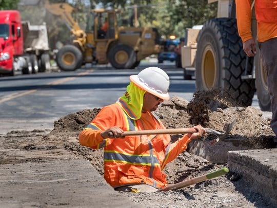 Jaime Barragan works with construction crews Monday, July 16, 2018 at Cherry Street and Tulare Avenue during the utility and street reconstruction project.