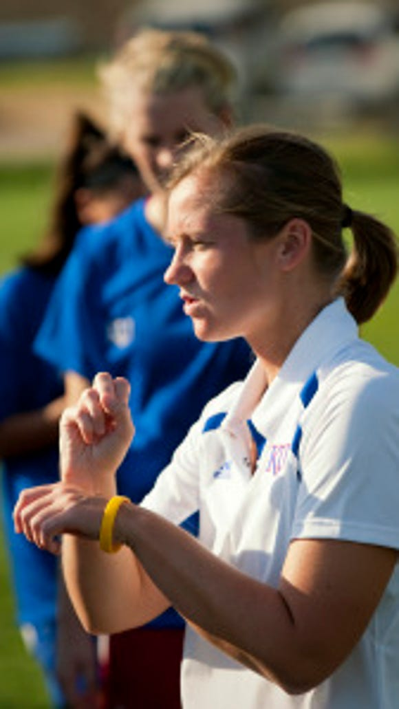 Sign language interpreter Catie Johnson signs instructions to University of Kansas women's soccer player Emily Cressy during a recent practice.  As a freshman, Cressy, who is deaf, was named Big-12 rookie of the Year  and 2008 USA Deaf Sports Federation Sportswoman of the Year. (Craig Hacker, Freelance)