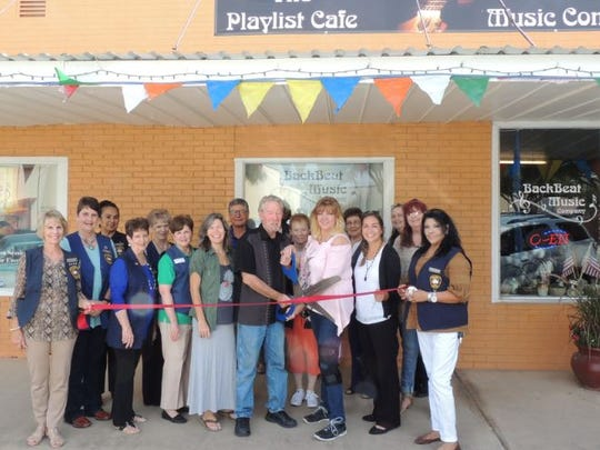 Downtown San Angelo, Inc.'s Del Velasquez joined the Chamber of Commerce's Concho Cadre to celebrate the grand opening of Playlist Café at 102 N. Chadbourne St. on Oct. 5, 2017. Holding the ceremonial scissors are owners Alexandra and Greg Cunningham.