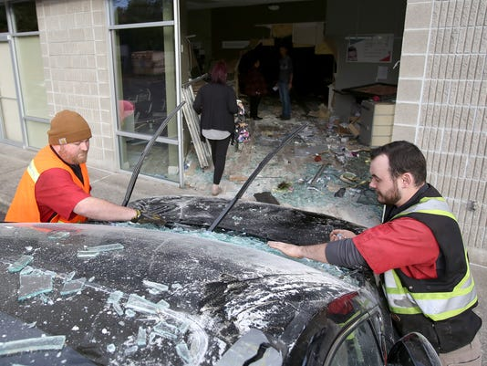 Car crashes into Great Clips