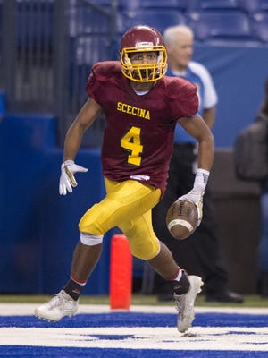 Indianapolis Scecina Memorial High School sophomore David Baker (4) runs into the end zone to score during the second half of IHSAA varsity football action at Lucas Oil Stadium, Friday, October 6, 2017. Scecina won the game, 27-14.