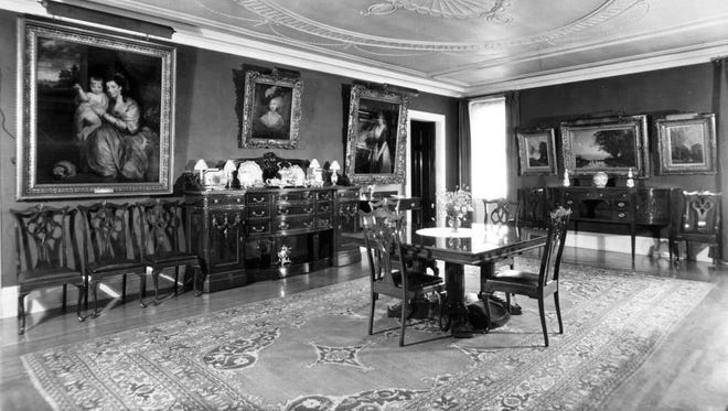 The dining room of the Taft home, now the Taft Museum of Art, circa 1925.
