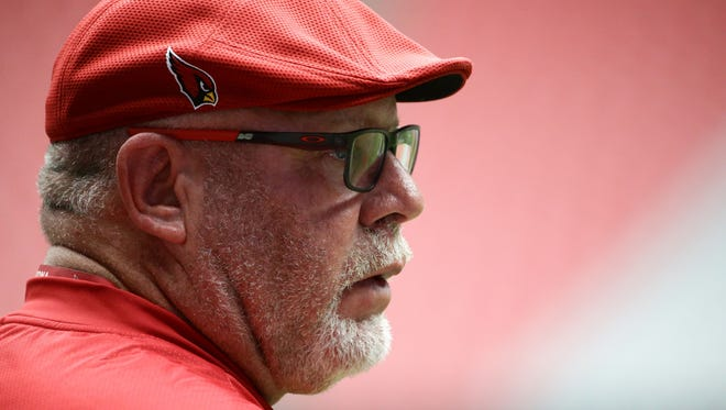 Arizona Cardinals head coach Bruce Arians arrives on the field for the run test on reporting day of training camp on Jul. 21, 2017 in Glendale, Ariz.