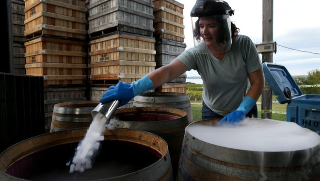 Nova Cadamatre uses dry ice while working on creating a 240 Days wine for Constellation Brands.