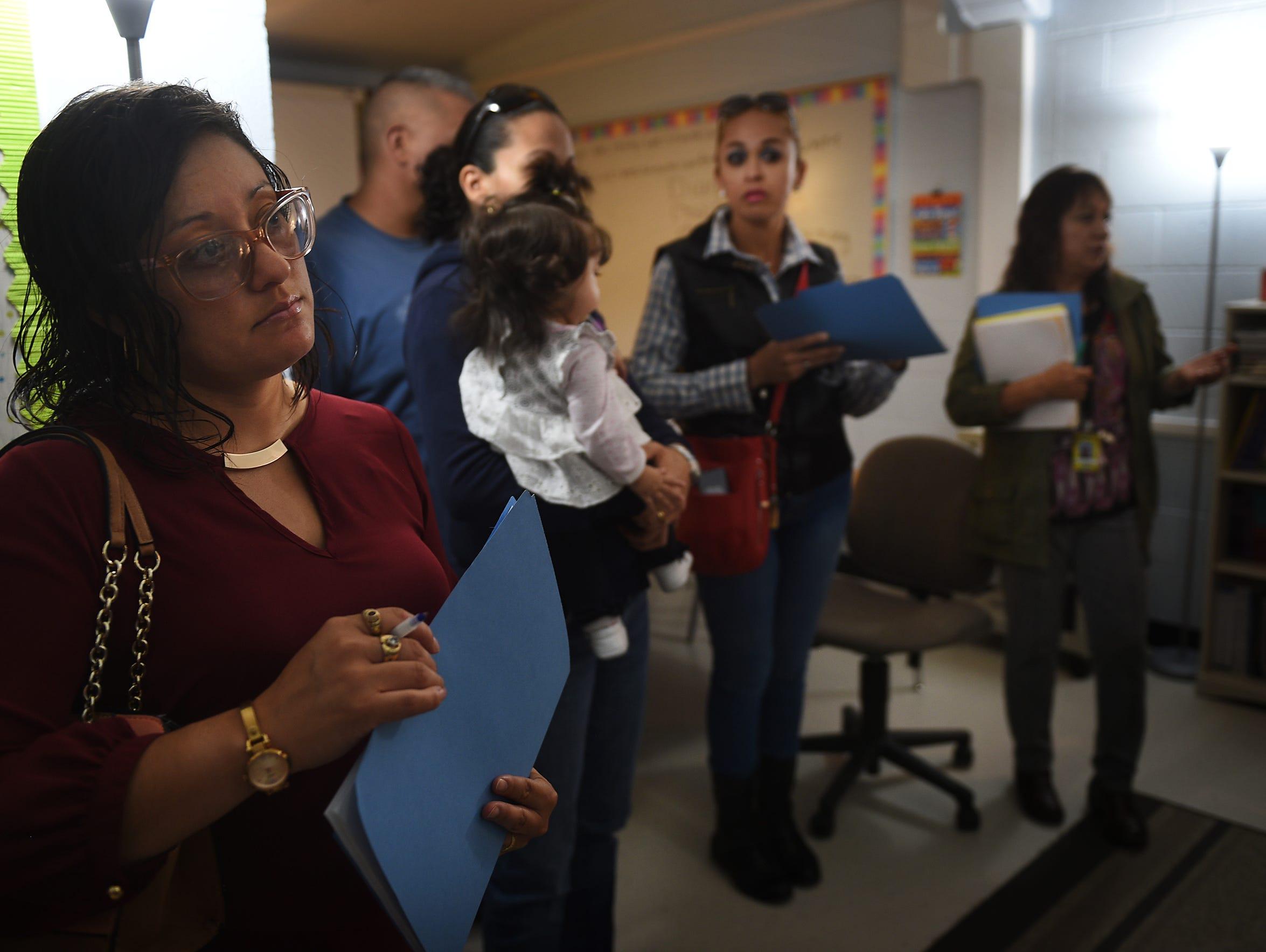 Concerned parent Lidia Rangel, left, listens with others