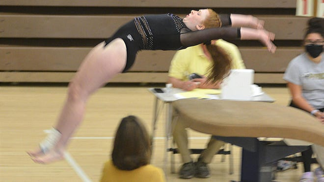 Newton gymnast Violet Bartley competes in the vault at the Newton Invitational.
