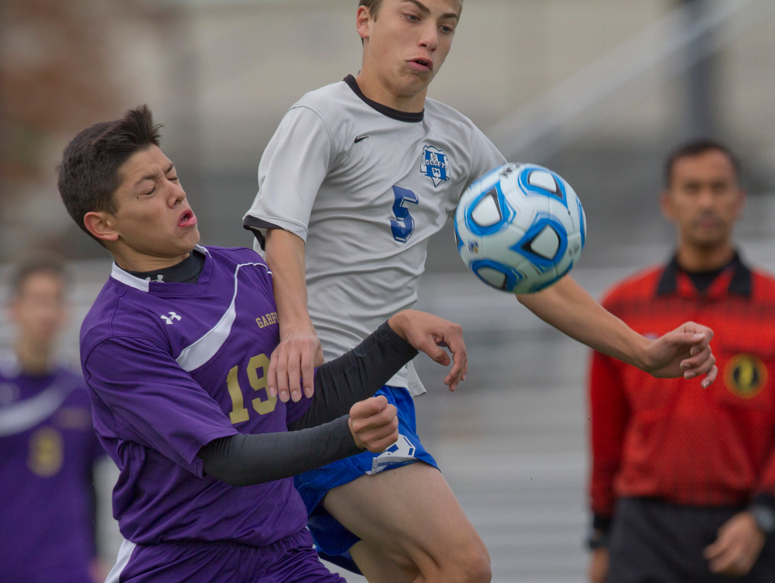 Garfield's Enrique Nunez and Holmdel's Joe Arena battle for ball during first half action. Holmdel Boys Soccer vs Garfield in NJSIAA State Group II Championship at Kean University on November 22, 2015 in Union, NJ.
