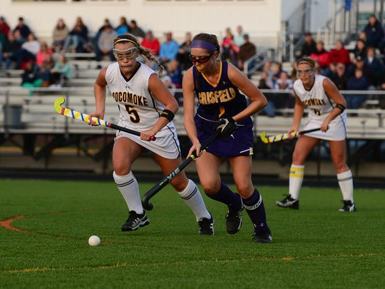 Pocomoke's McKenzie Mitchell takes on Crisfield's Mallory Doyden.