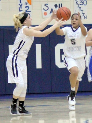Silver's Asia Morales, left, and LeAsiah Jaure play hot potato with the basketball after a fast break Tuesday night at home against Socorro.