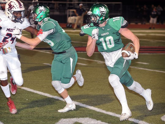 Iowa Park's Kason Dickerson (10) runs around the end off of a block from teammate Kaden Ashlock (29) Friday night against the Waxahachie Life Mustangs in Gainseville.