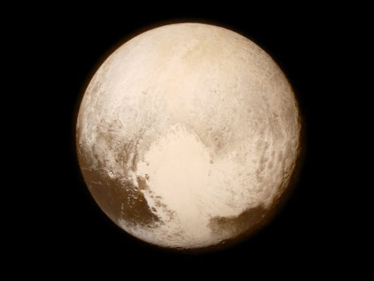 """NASA via AP   This image provided by NASA shows  Pluto seen from the New Horizons spacecraft. Other images from the historic mission will be projected as part of """"Plutopalooza: Night Under the Stars,"""" an over-21 celebration from 6:30 to 9:30 Saturday in the Branigan Cultural Center. There will also be hands-on-activities, a last chance to see an exhibit about Pluto's discoverer Clyde Tombaugh, a no-host bar and food truck treats."""