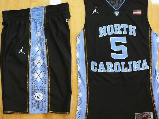 King Rice gives positive reaction on black UNC jerseys