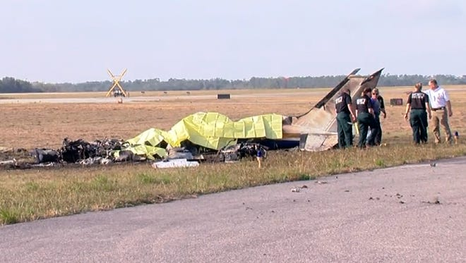 The charred remains of a Cessna 340 twin-engine aircraft sat north of a runway Dec. 24, 2017, at Bartow (Fla.) Municipal Airport. Five people on their way to the Florida Keys for a day trip were killed in dense fog at sunrise.