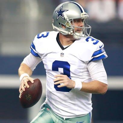 Aug 28, 2014; Arlington, TX, USA; Dallas Cowboys quarterback