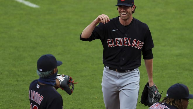 The Indians' Shane Bieber, right, reacts between innings during a game against the Cincinnati Redson Tuesday.