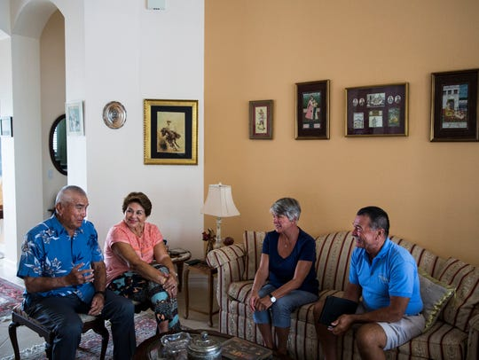 Luis and Maria Chirichigno, from left, talk about the Vietnam War with Diane and Craig Megargle in North Naples on Friday, Nov. 3, 2017. The Megargles, of Connecticut, while planning to visit a friend on Marco Island, called Luis to ask whether they could meet to give him a MIA bracelet engraved with his name. Diane had purchased it in the 1970s when he went missing during the Vietnam War.