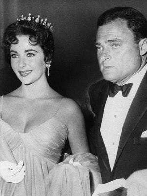 Actress Elizabeth Taylor is seen with her husband producer Mike Todd in 1957.