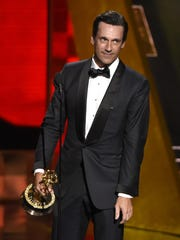 Jon Hamm accepts the award for outstanding lead actor in a drama series for Mad Men at the 67th Primetime Emmy Awards on Sunday at the Microsoft Theater in Los Angeles.