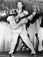 Elvis Presley performs in 1956. This photo was used