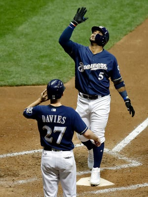 Jonathan Villar crosses home plate as Zach Davies waits to congratulate him after he hit a two-run homer in the bottom of the fifth inning for the Brewers on Thursday night against the Nationals at Miller Park.