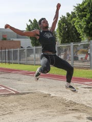 James Green jumps in the long jump during the DVL field event finals at Palm Desert High School, April 30, 2018