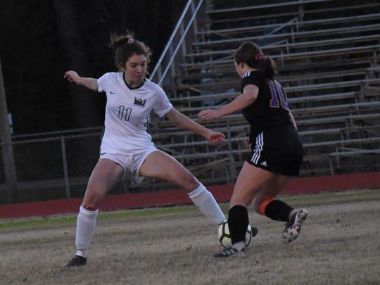 Menard sophomore Mia Miguez (11) tries to defend ASH
