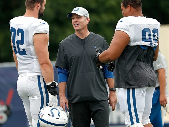 Indianapolis Colts defensive coordinator Matt Eberflus talks with Margus Hunt (92) and Al Woods (99) during their joint practice at Grand Park in Westfield on Friday Aug 17.