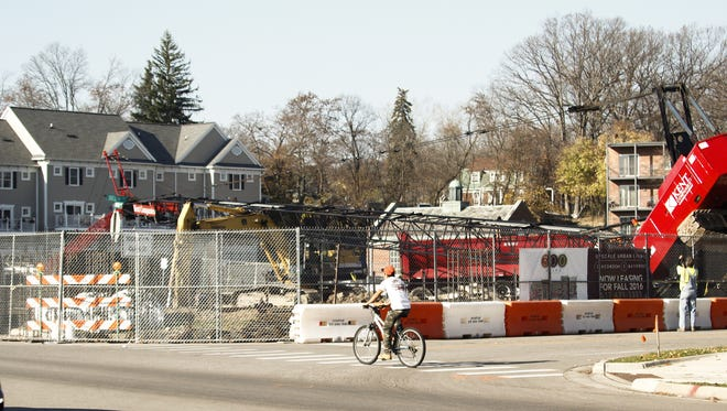 A crane tipped onto one track at a construction site near the corner of Delta Street and Grand River Avenue in East Lansing Wednesday afternoon at a construction site in East Lansing near the West Village Condos.