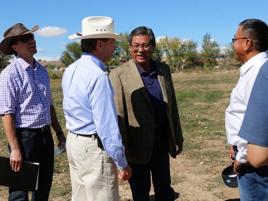 U.S. Sen. Tom Udall, second from left, and Navajo Nation President Russell Begaye visit Earl and Cheryle Yazzie's farm Friday in Shiprock.