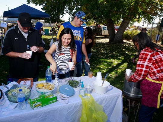 Heath, left, Michelle and C.J. Barker, 16, try Olivia Montoya's pork and beef posole during the Bloomfield Boys & Girls Clubs posole cook-off Saturday at Salmon Park in Bloomfield.
