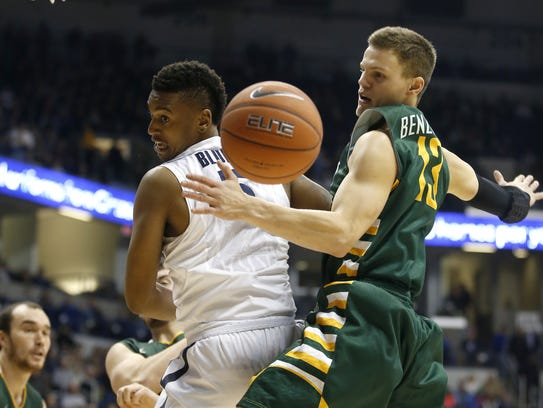 Xavier Musketeers guard Trevon Bluiett (5), left, and