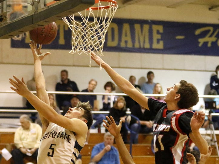 Gary Raupers goes up for a layup as Jason Davis tries