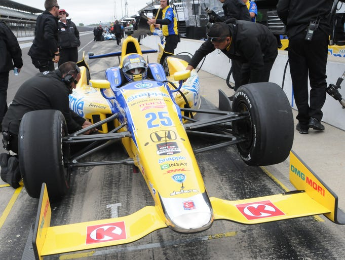 Marco  Andretti waits in the car while changes are made during practice for the 2014 Indy 500 , Wednesday ,  May 14,  2014  at The Indianapolis Motor Speedway.