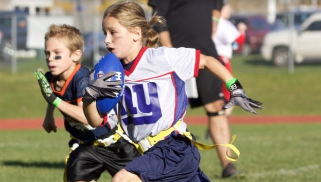 Elly Evarts, 7, is a force to be reckoned with on the football field.