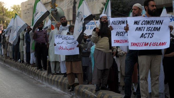 Pakistanis protest Saturday in Karachi against the printing of satirical sketches of the prophet Mohammed.