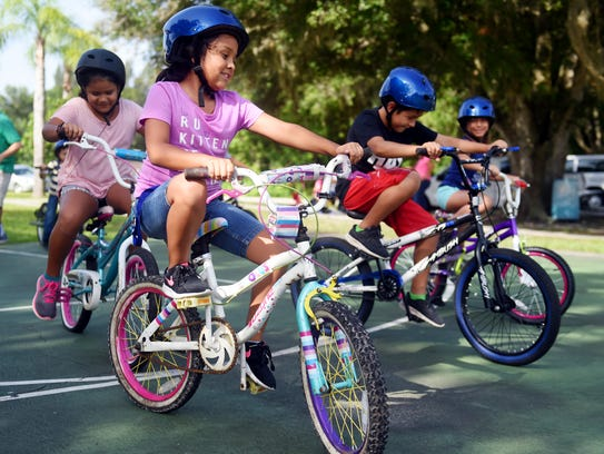 """Alexa Avelar, of Fellsmere, participated in a bike rodeo, Friday, Aug. 4, 2017, at a community event held by the Fellsmere Action Community Team at Grant Park in Fellsmere. """"Florida is the worst state in the country for bicycle safety for a variety of reasons,"""" said Phillip Matson, staff director for the Metropolitan Planning Organization."""