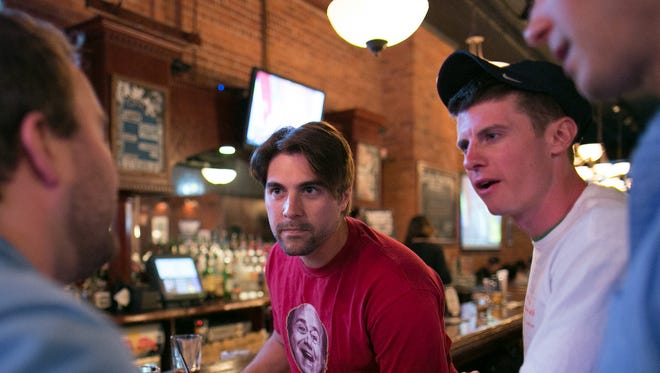 From left to right, Brett Langdon, Eric Mueller, Kevin Cleland, and Mark Hasman compete during a trivia competition at Scotland Yard Pub on St. Paul Street in Rochester on Wednesday, May 6, 2015.