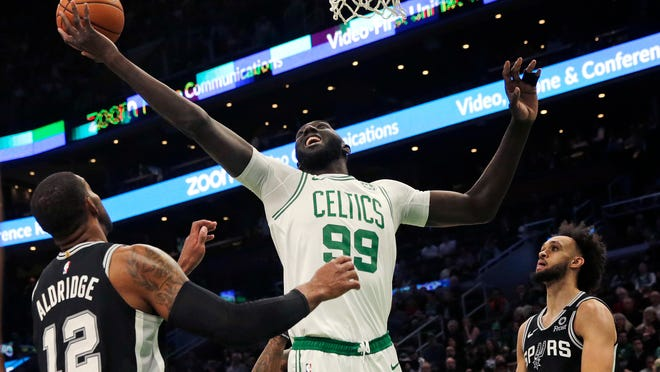 Boston Celtics center Tacko Fall (99) grabs a rebound over San Antonio Spurs center LaMarcus Aldridge (12) during the fourth quarter of an NBA basketball game Wednesday, Jan. 8, 2020 in Boston.