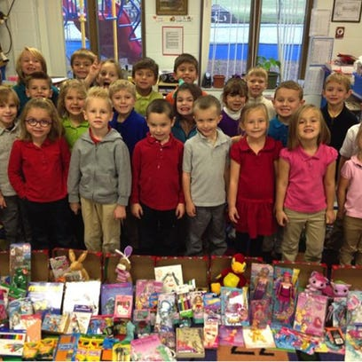 Shepherd of the Lakes students stand with contributions to the personal-needs pantry.